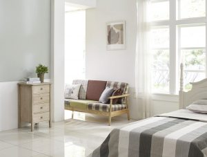 Bedroom in light colors walls and furniture